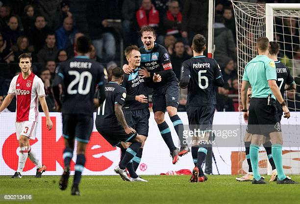 PSV Eindhoven's Siem de Jong celebrates with teammates after scoring a goal during the Dutch League football match between AFC Ajax and PSV Eindhoven...