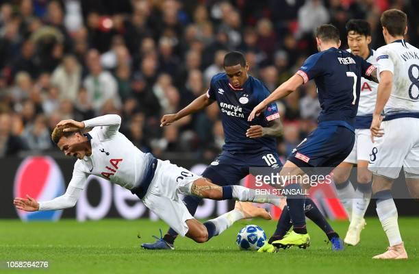 PSV Eindhoven's Uruguayan midfielder Gaston Pereiro fouls Tottenham Hotspur's English midfielder Dele Alli during the Champions League group B...