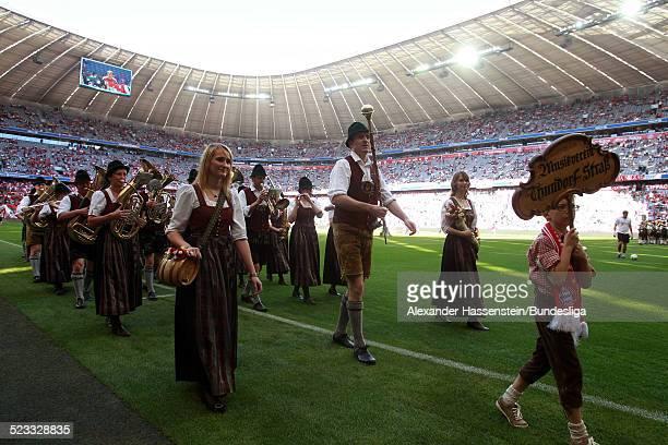 Eine traditionell bayrische Blaskapelle spielt vor dem Bundesliga Spiel zwischen FC Bayern Muenchen und VfB Stuttgart in der Allianz Arena April 28...