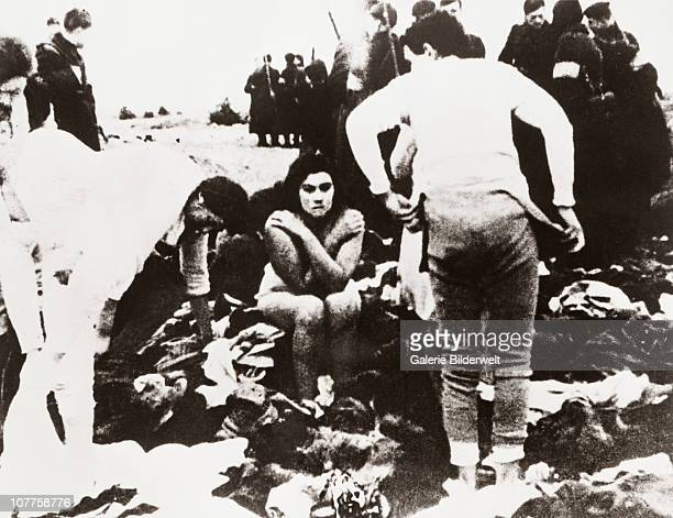 Einsatzgruppen Massacre Members of a SS Einsatzgruppe are forcing Jews to undress for execution 1941 Front Max Epstein and his sister Lea Skede near...
