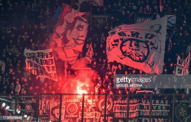 Eintracht fans cheer during the UEFA Europa League round of 16 second leg football match Inter Milan vs Eintracht Frankfurt on March 14 2019 at the...