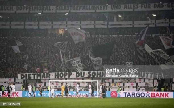 Eintracht Frankfurt fans display a protest banner against Dietmar Hopp chief financial backer of TSG 1899 Hoffenheim during the DFB Cup quarterfinal...