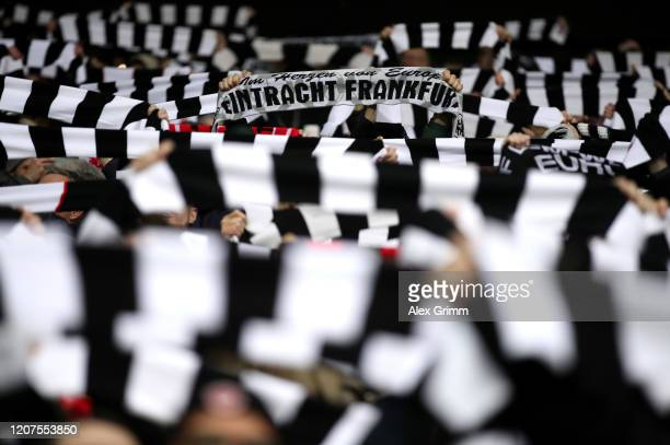 Eintracht Frankfurt fans pay tribute to the victims of the Hanau shootings prior to the UEFA Europa League round of 32 first leg match between...
