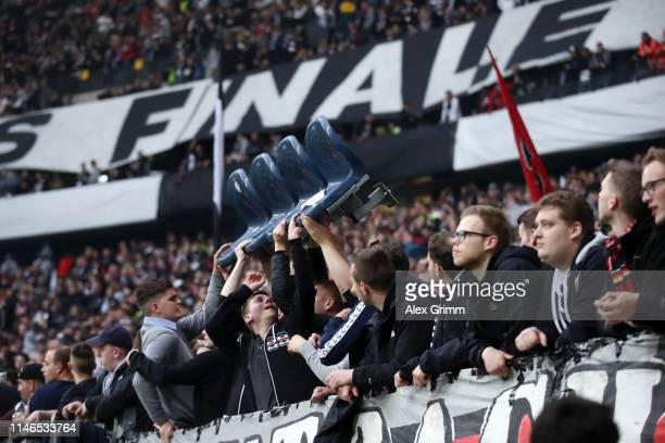 Eintracht Frankfurt fans remove seats from the stands prior to the UEFA Europa League Semi Final First Leg match between Eintracht Frankfurt and...