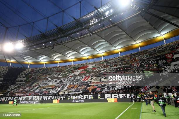 Eintracht Frankfurt fans welcome their team prior to with a 'tifo' display prior to the UEFA Europa League Semi Final First Leg match between...