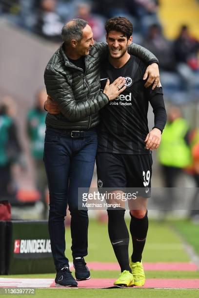 Eintracht Frankfurt Manager / Head Coach Adi Hutter hugs Goncalo Paciencia as is substituted during the Bundesliga match between Eintracht Frankfurt...