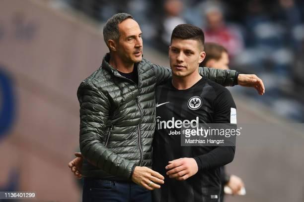 Eintracht Frankfurt Manager / Head Coach Adi Hutter hugs Luka Jovic as he is substituted during the Bundesliga match between Eintracht Frankfurt and...