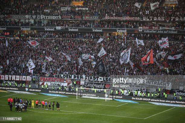 Eintracht Frankfurt players acknowledge their supporters at the end the Bundesliga match between Eintracht Frankfurt and 1. FSV Mainz 05 at...