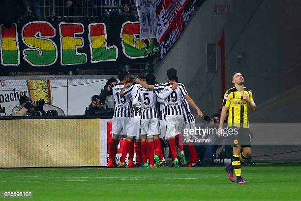 Eintracht Frankfurt players celebrate their team's first goal by Szabolcs Huszti during the Bundesliga match between Eintracht Frankfurt and Borussia...