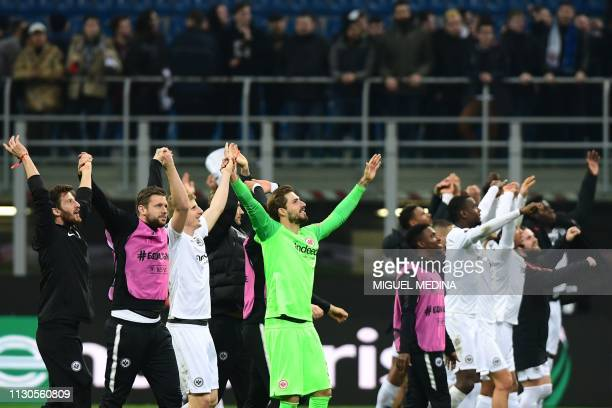 Eintracht Frankfurt's German goalkeeper Kevin Trapp and teammates acknowledge fans at the end of the UEFA Europa League round of 16 second leg...