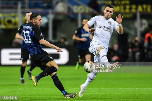 Eintracht Frankfurt's Serbian forward Filip Kostic defends against Inter Milan's Italian defender Danilo D'Ambrosio during the UEFA Europa League...