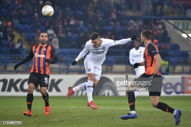 Eintracht Frankfurt's Serbian forward Luka Jovic heads the ball during the UEFA Europa League round of 32 firstleg football match between FC Shakhtar...