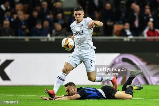 Eintracht Frankfurt's Serbian forward Luka Jovic outruns Inter Milan's Dutch defender Stefan de Vrij to open the scoring during the UEFA Europa...