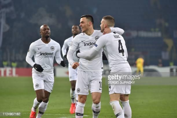 Eintracht Frankfurt's Serbian midfielder Filip Kostic jubilates after scoring a goal during the UEFA Europa League round of 32 firstleg football...