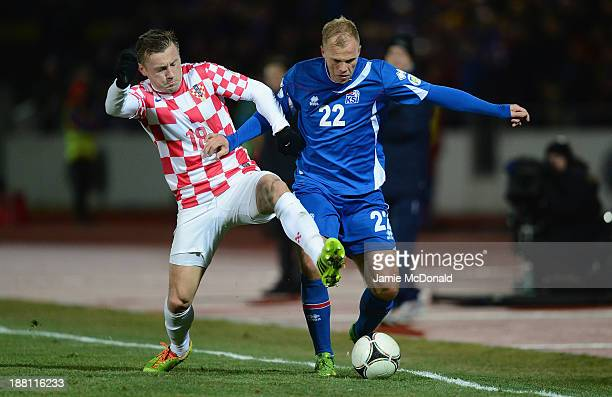Eiour Smari Guojohnson of Iceland battles with Ivica Olic of Croatia during the FIFA 2014 World Cup Qualifier Playoff First Leg match between Iceland...