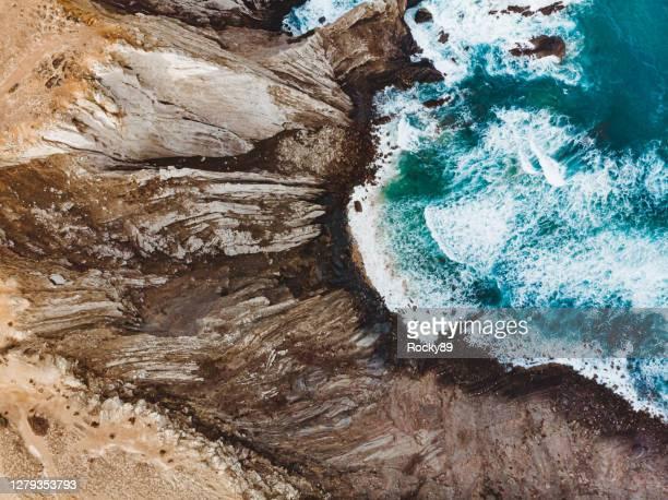 eiras near sagres beach, algarve, portugal - drone shot - rocky coastline stock pictures, royalty-free photos & images