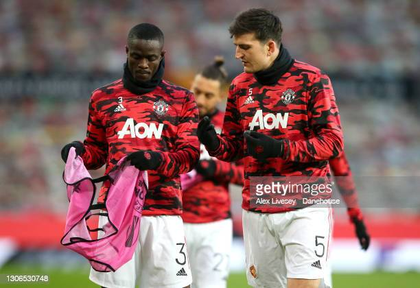 Eirc Bailly and Harry Maguire of Manchester United warm up ahead of the UEFA Europa League Round of 16 First Leg match between Manchester United and...