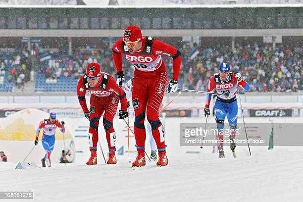 Eirik Brandsdahl of Norway and Petter Northug of Norway lead a group in the men's individual sprint Cross Country Skiing during the FIS World Cup on...