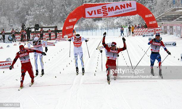 Eirik Brandsdahl of Norway Ola Vigen Hattestad of Norway Nikita Kriukov of Russia fight for the victory in the men's individual sprint Cross Country...