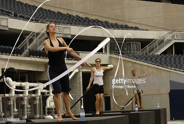 Eirini Aindili from left Mandy James and Anthony Bryant rehearse their rhythmic gymnastics for opening ceremonies of the Gay Games 2006 at Soldier...