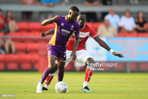 Eisa Mohammed of Cheltenham Town in action with Famara Diedhiou of Bristol City during the PreSeason Friendly between Bristol City v Cheltenham Town...