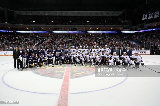 Eisbaren Berlin and the Chicago Blackhawks take a group photo after the NHL Global Series Challenge 2019 match at Mercedes-Benz Arena on September...
