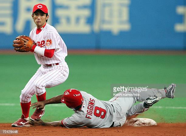 Eishin Soyogi of Hiroshima Toyo Carp forces out Chone Figgins of the Los Angeles Angels of Anaheim at the second base during the Aeon All Star Series...