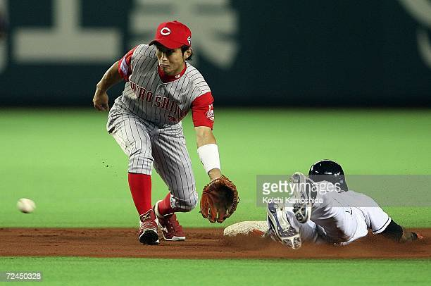 Eishin Soyogi of Hiroshima Toyo Carp in position to catch the ball while Jose Reyes of the New York Mets slides into the second base during the Aeon...