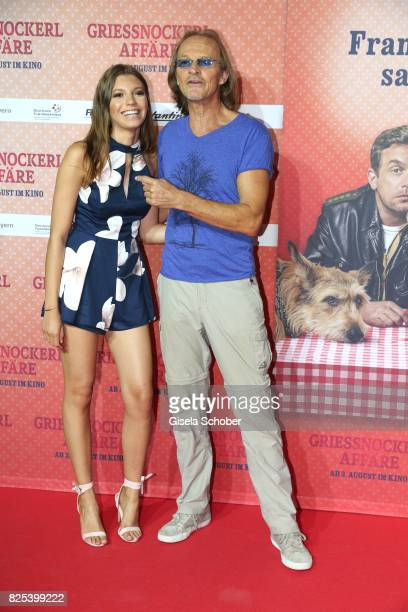 Eisi Gulp and his daughter Aliyah during the 'Griessnockerlaffaere' premiere at Mathaeser Filmpalast on August 1 2017 in Munich Germany