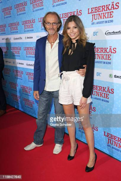 "Eisi Gulp and his daughter Aliyah during the premiere of the Eberhofer Krimi ""Leberkaesjunkie"" at Mathaeser Filmpalast on July 29, 2019 in Munich,..."