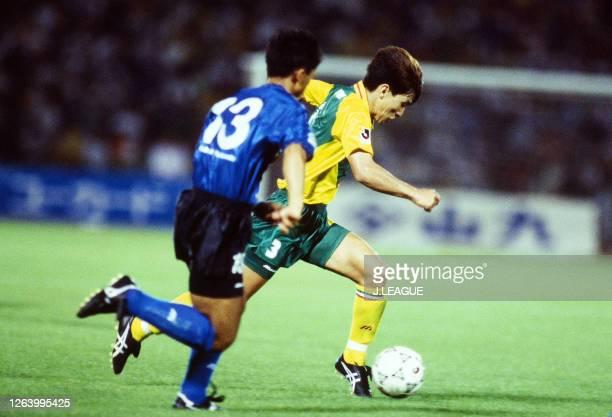 Eisuke Nakanishi of JEF United Ichihara controls the ball under pressure of Kazuaki Koezuka of Gamba Osaka during the J.League Suntory Series match...