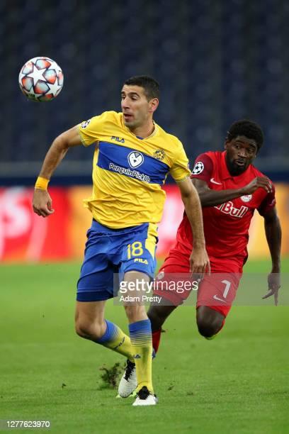 Eitan Tibi of Maccabi Tel-Aviv battles for possession with Sekou Koita of RB Salzburg during the UEFA Champions League Play-Off second leg match...
