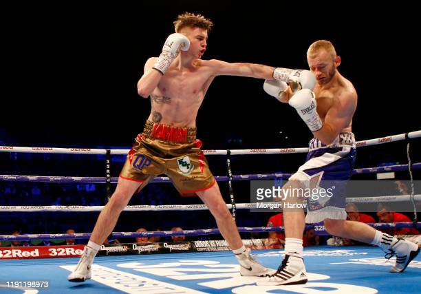 Eithan James punches Daryl Pearce during the SuperLightweight Contest between Eithan James and Daryl Pearce at Arena Birmingham on November 30 2019...