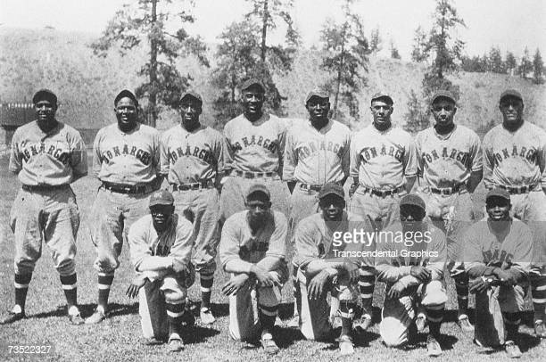 Either on a barnstorming trip or a spring training stay, the Kansas City Monarchs of 1934 pose for a team photo. Bullet Rogan is posed in the middle...