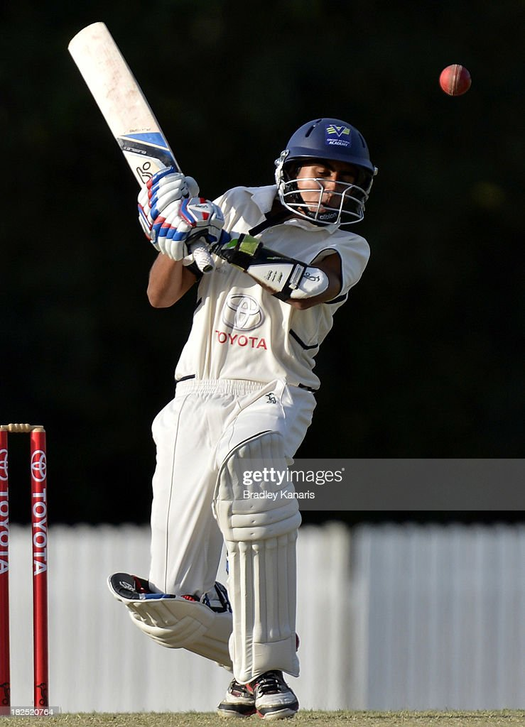 Ejaaz Alavi of Victoria avoids a bouncer during day one of the Futures League match between Queensland and Victoria at Allan Border Field on September 30, 2013 in Brisbane, Australia.