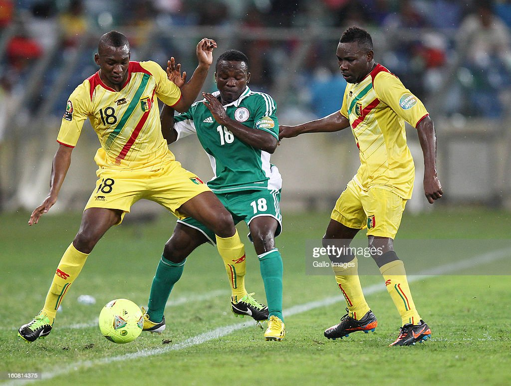 Ejike Uzoenyi of Nigeria and Samba Sow of Mali battle for the ball during the 2013 Orange African Cup of Nations 1st Semi Final match between Mali and Nigeria at Moses Mabhida Stadium on February 06, 2013 in Durban, South Africa.