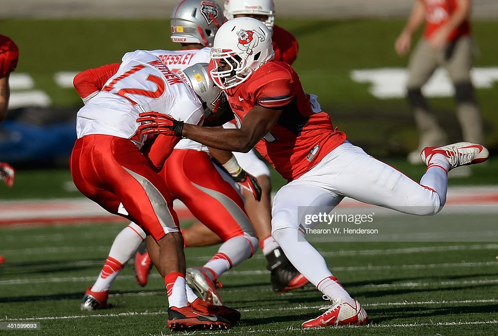 Ejiro Ederaine #31 of the Fresno State Bulldogs sacks quarterback Clayton Mitchem #12 of the New Mexico Lobos during the second quarter at Bulldog Stadium on November 23, 2013 in Fresno, California.