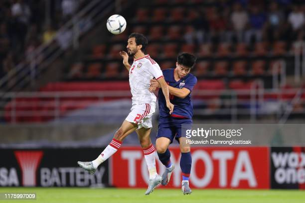 Ekanit Panya of Thailand and Mohamed Barghash of United Arab Emirates compete for the ball during the FIFA World Cup Asian Qualifier second round...