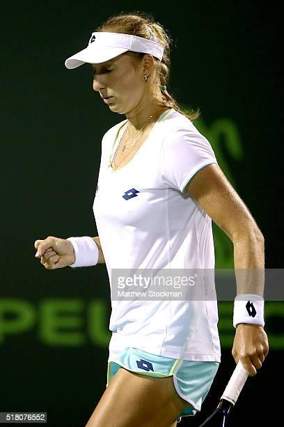 Ekatarina Makarova of Russia celebrtaes apoint while playing Svetlana Kuznetsova of Russia during the Miami Open presented by Itau at Crandon Park...