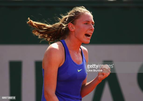 Ekaterina Alexandrova of Russia celebrates during the ladies singles first round match against Katerina Siniakova of The Czech Republic on day two of...