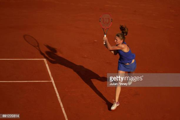 Ekaterina Alexandrova of Russia hits a backhand during the ladies singles second round match against Karolina Pliskova of the Czech Republic on day...