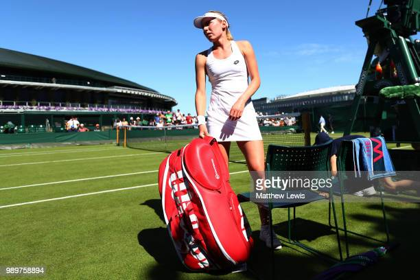 Ekaterina Alexandrova of Russia packs her bag after being defeated in her Ladies' Singles first round match against Victoria Azarenka of Belarus on...
