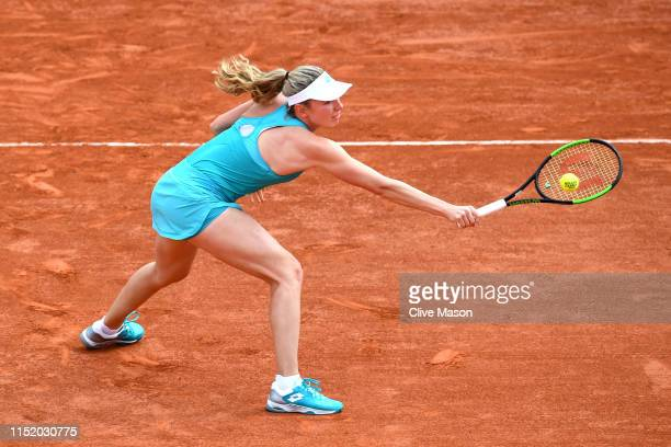 Ekaterina Alexandrova of Russia plays a backhand during her ladies singles first round match against Mihaela Buzarnescu of Romania during Day two of...