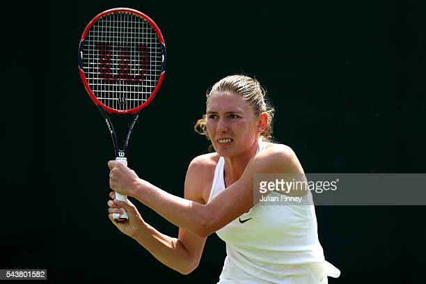 Ekaterina Alexandrova of Russia plays a backhand during the Ladies Singles second round match against AnnaLena Friedsman of Germany on day four of...