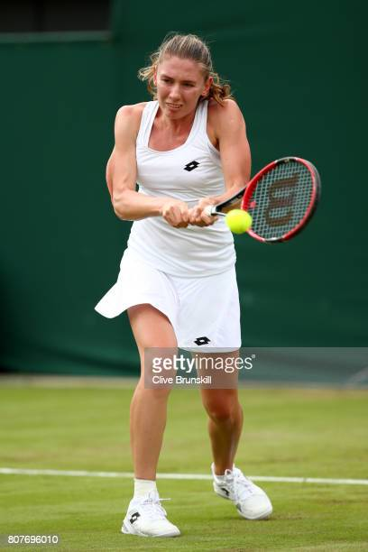 Ekaterina Alexandrova of Russia plays a backhand during the Ladies Singles first round match against Garbine Muguruza of Spain day two of the...