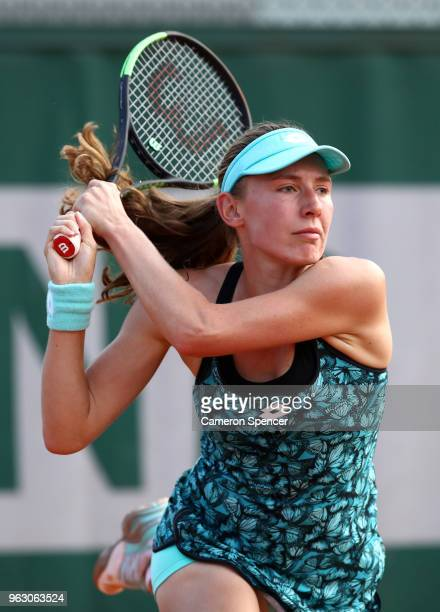 Ekaterina Alexandrova of Russia plays a backhand during the ladies singles first round match against Magdanela French of Poland during day one of the...