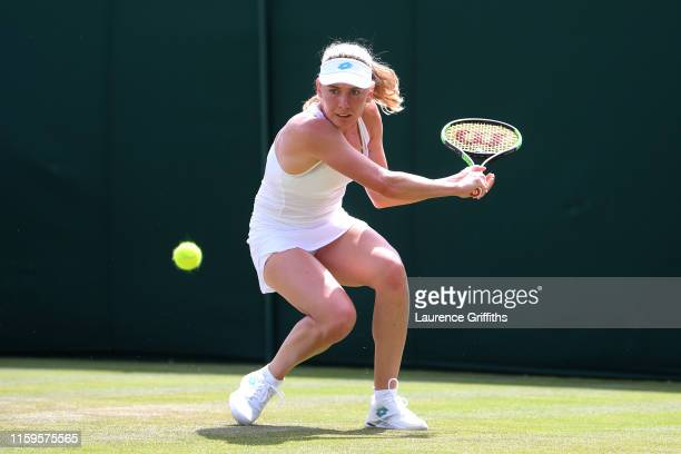 Ekaterina Alexandrova of Russia plays a backhand in her Ladies' Singles first round match against Katerina Siniakova of The Czech Republic during Day...
