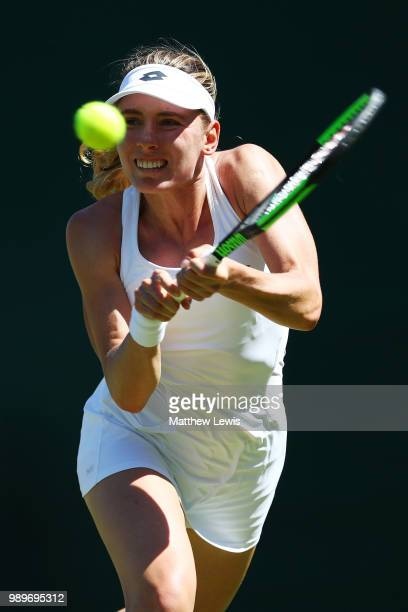Ekaterina Alexandrova of Russia plays a backhand in her Ladies' Singles first round match against Victoria Azarenka of Belarus on day one of the...