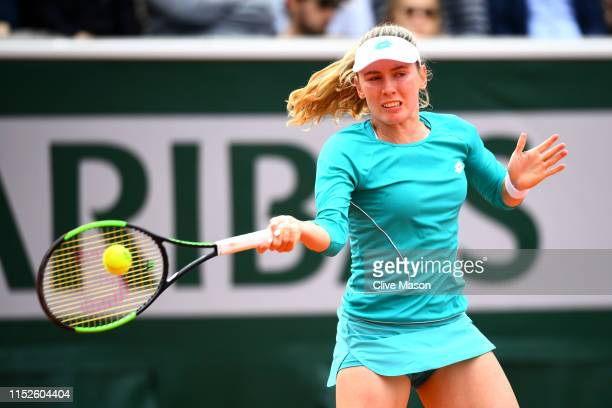 Ekaterina Alexandrova of Russia plays a forehand during her ladies singles second round match against Samantha Stosur of Australia during Day five of...