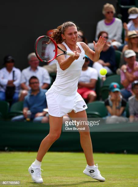 Ekaterina Alexandrova of Russia plays a forehand during the Ladies Singles first round match against Garbine Muguruza of Spain day two of the...